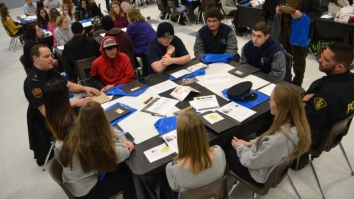 group of students around a table